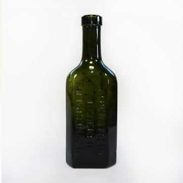 Zöld színű gyógyszeres üveg